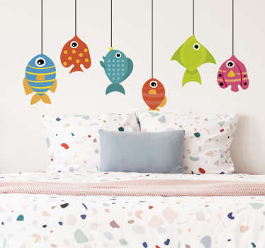 For a joyfull and funny atmosphere, this drawing wall sticker of several colorful fishes will fit perfectly to the bedroom of your children !