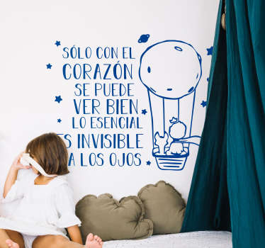 """Mural infantil formado por la ilustración del Principito y el texto """"Sólo con el corazón se puede ver bien, lo esencial es invisible a los ojos""""."""