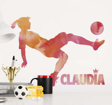 A soccer sport wall decal with the design of a player kicking a ball. A lovely silhouette football player that can be personalized in nay name.