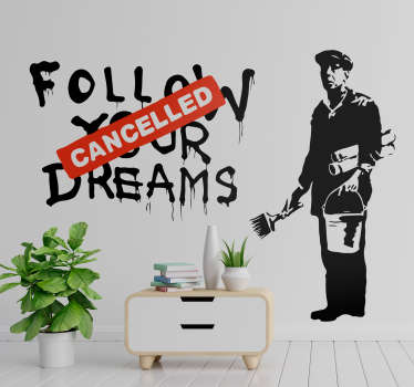 "Decorate your wall with this Banksy wall art sticker, that shows his graffiti with the text ""Follow your dreams"" cancelled by a red sign."