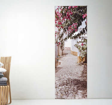 Decorative door vinyl decal design of a calm and beautiful street with flowers. Chose the measure of size that will adapt well to the desired surface.