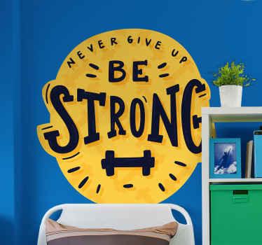 """Dekoratívna motivácia text vinylová nálepka, ktorá hovorí: """"byť silný"""". Vzor vyrobený na žltom okrúhlom pozadí so špeciálnymi znakmi."""
