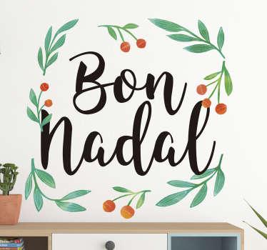 """Pegatina formada por el texto """"Bon Nadal""""enmarcado por unas plantas con frutos naranjas. Fácil aplicación y sin burbujas."""