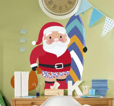 Pegatina formada por el diseño de Papá Noel vestido con un bañador de flores y sujetando una tabla de surf. Vinilos Personalizados a medida.