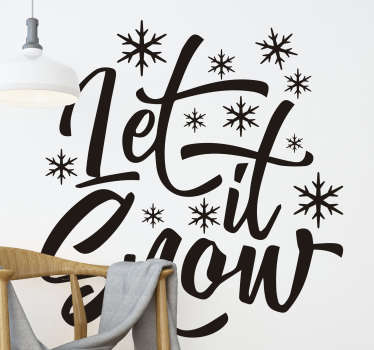Easy to apply decorative Christmas wall decal with text '' let it snow'' in lovely styled font and spacial features on it..