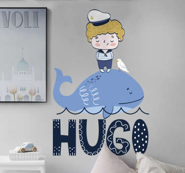 Adhesive decorative  nautical vinyl sticker of a child sailor standing on a big sea fish with a name that can be personalised for you .