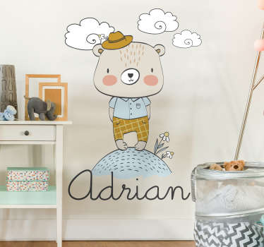 Decorative wall decal of a bear in the field with a customisable name for any kid to beautify the wall space in the bedroom for a child.