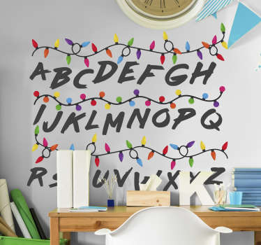 Stranger things wall decal created with colourful light bulbs in two lines and alphabet from A-Z.  Easy to apply design and you can chose the size.