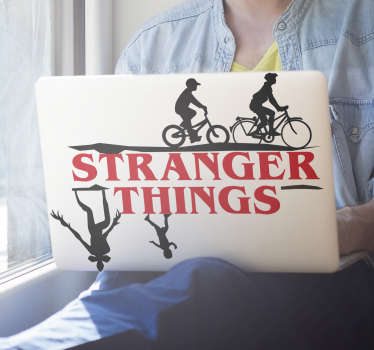 Stranger Things series laptop skin sticker design. This design contains  two boy from the movie on their bicycle with the monster from upside .