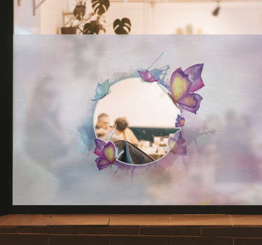 This is a design of  coloured butterfly on transparent background window sticker with a transparent circle for a see through on the environment.