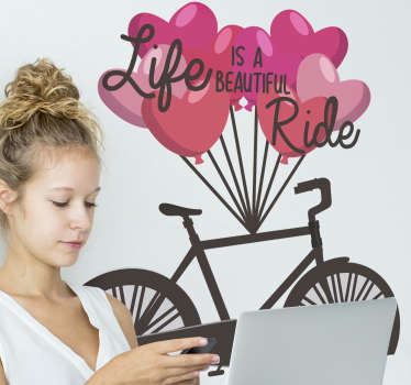 Life is a beautiful ride cycling wall sticker design of a bicycle in black colour with red love balloons hang on it with beautiful text in black .