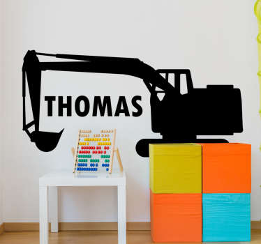 A customise digger for kids with a name wall sticker in black silhouette. This product can be in any size of your choice with the name you want.