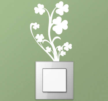 A shamrock plant light switch wall decal designed in white colour with a very flourishing looking patterned branches. Easy to apply on flat surface.