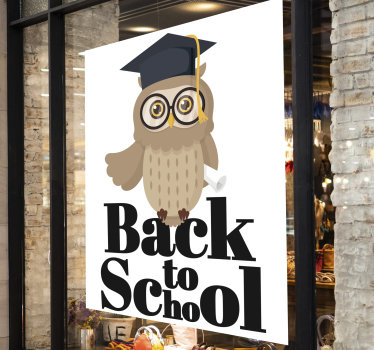 Front window holiday sales sticker designed with an owl using a graduation costumes.This design symbolises excellence for school sales. Easy to apply.