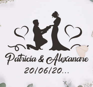 Wedding vinyl car sticker design of a couple with the man on his kneels on from of his woman. it contains text with the name and date customisable.