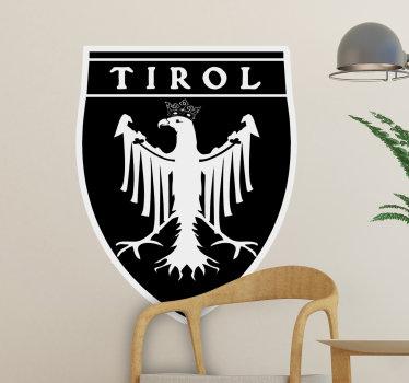 Una sticker da muro bandiera del design tirol con tutte le sue caratteristiche complete che detiene il simbolo della posizione su un colore bianco e nero.