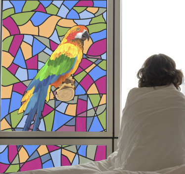 Easy to apply window decal for your home, the design host a funny parrot on a tree log stain  on a geometric colourful background.