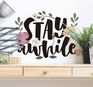 Easy to apply home wall decal with flower and a text that stays '' stay a while'' Beautiful and persuasive design to keep your visitors to spent time.