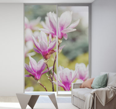 Decorative window sticker for living room designed with a magnolia flower with a translucent background appearance to add glam to the home.