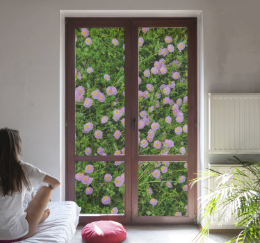 A decorative window decal of a plant created in the appearance of a garden with pretty colorful floral that will beautify the window.