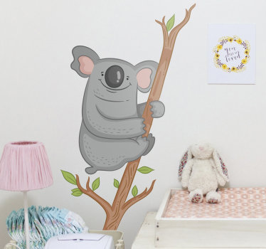 Easy to apply kids room wall sticker of a koala animal on a tree branch with it leave that you will love and the child will admire it.