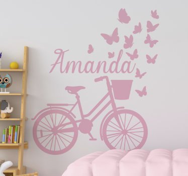 A customisable name wall decal for kids room with a spring bicycle. Design created with a bike with butterflies and a name of your choice and colour.