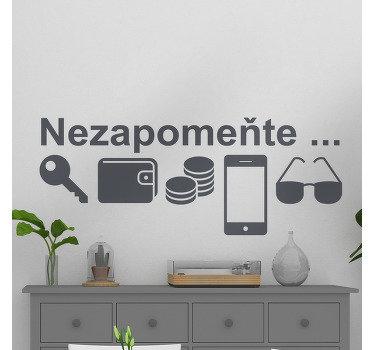 """Dekorativní obtisky na domácí stěně běžně používaných předmětů, jako jsou klíče, telefon, brýle a další, s textem """"nezapomeň na mě""""."""