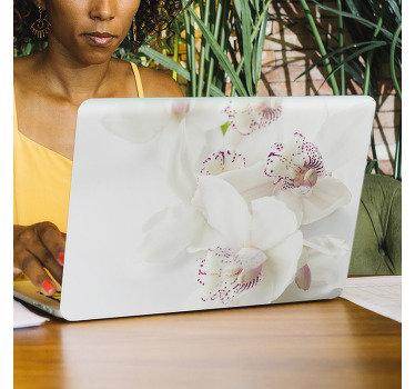 Kaufen sie unseren wunderschönen vinyl-laptop-aufkleber mit dem design einer weißen orchideenpflanze, die der oberfläche jedes laptops einen sanften hauch von schönheit verleiht.