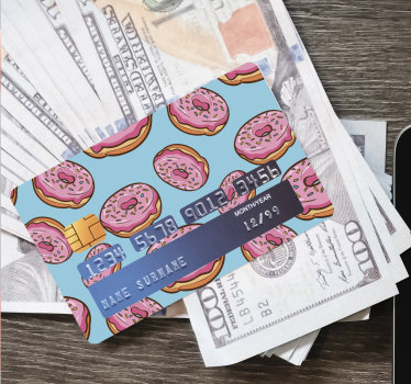 Decorative sticker vinyl for bank credit card designed with donuts. The design is easy to apply with the reveal area of the account details.