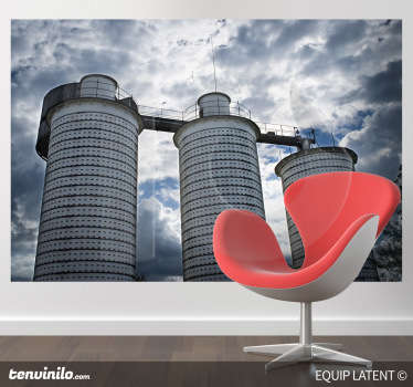 Photo Mural - Factory shot of three large towers under a cloudy sky. Ideal feature for decorating your home or business.