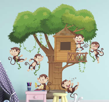 Decorative wall art sticker for children with the design of monkeys playing on a tree with a house on top of it. A fascinating design for kids room.