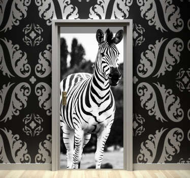 Best quality vinyl door sticker with the design of a black and white zebra on it in an original visual appearance. Easy to apply.