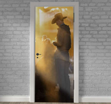 Decorative door vinyl sticker of a cowboy standing in a typical background appearance. Easy to apply on any flat surface.