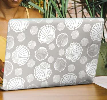 Achetez notre autocollant décoratif en vinyle pour ordinateur portable avec le design de la coquille de mer de couleur grise et blanche. Achetez-le dans la taille qui correspond à votre ordinateur portable.