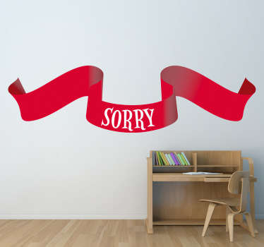 A red ribbon wall sticker with the text 'sorry'. Great text decal to decorate your home and apologise to someone.
