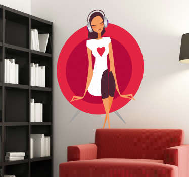A wall decal of a young lady sitting in a sofa wearing a white top with a read heart in the middle and listening to music.