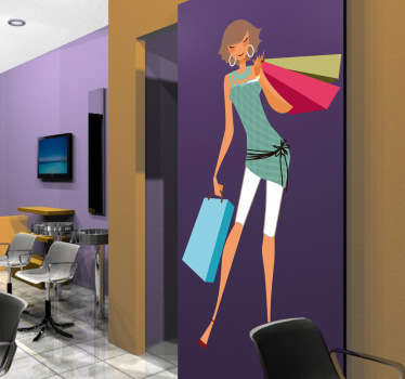 Sticker illustrating a young elegant woman with her shopping bags. Superb decal to decorate your office or shop front window.