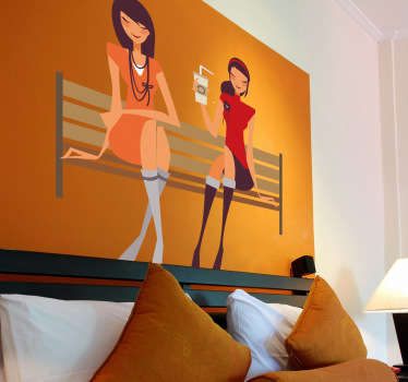 A wall sticker of two beautiful young ladies sitting down in the park bench whilst talking and having a drink.