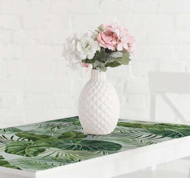 Película autocolante para móveis com o design de folhas de samambaia. Um produto idealizado para cobrir a superfície de mesas e armários.