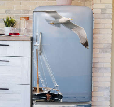 Fridge wrap vinyl sticker to decorate a fridge with the image of a seagull flying over a ship. It is available in any required dimension.