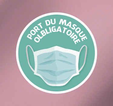 Sticker mural pour le port du masque. Ce sticker covid est conçu sur un fond rond de couleur verte avec un dessin de masque imprimé dessus. Application facile et taille au choix.