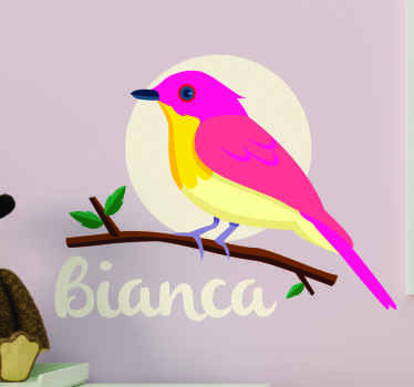 A bird wall art sticker designed in a pink and yellow colour, featured on a tree branch. It is easy to apply and made from high quality vinyl.