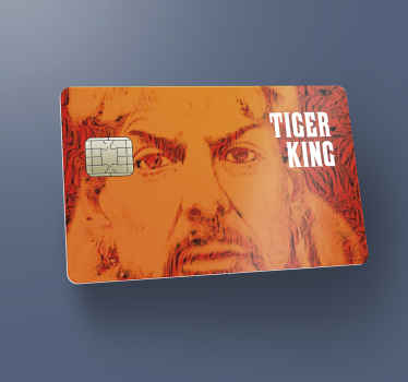 A debit card vinyl decal with the design of tiger king movie character. It is designed to fit nicely on a bank credit card.