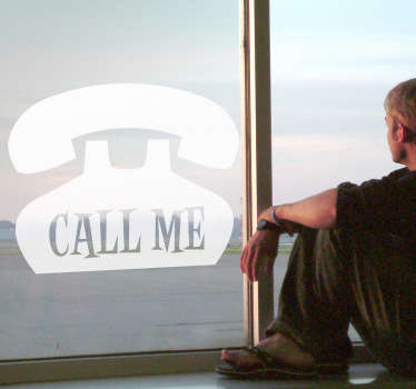 "A mono-colour decal of an old style telephone with the words ""call me"" inside."