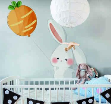 Un bonito vinilo habitación bebé de un conejito sosteniendo un globoideal para las habitaciones de los niños ¡Decora a tu gusto ahora!