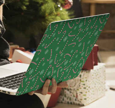 A decorative Christmas laptop decal design  featured with snowflakes and candy stick prints on green background. Easy to apply and of good quality.