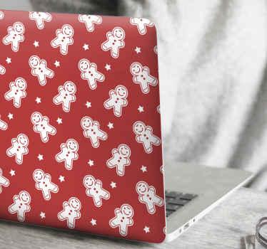 Kerstkoekjes laptop sticker ontwerp met print gemaakt in meerdere patronen. De achtergrond wordt ontvangen in rode kleur om perfecte kerstmis af te beelden.