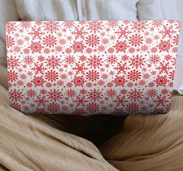 Decoratieve rode sneeuwvlokken laptop sticker voor elk laptop apparaat. Het ontwerp is een rood siersneeuwvlokkenpatroonontwerp dat sneeuwdaling illustreert.