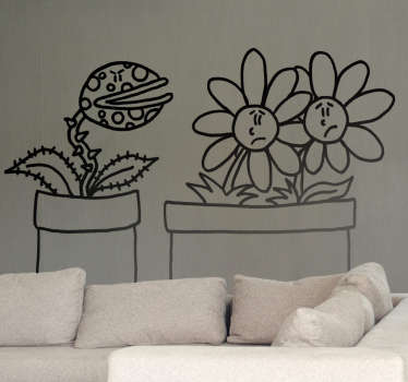 Adesivo murale che raffigura una pianta carnivora che sembra avere cattive intenzioni nei confronti di due indifese margherite. Un disegno originale di Deia.