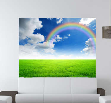 A fantastic view of a greenfield with on a clear day with a rainbow and clouds. A decal from our collection of rainbow wall stickers.